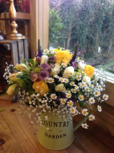 Beautiful Spring Flowers in a Country Jug